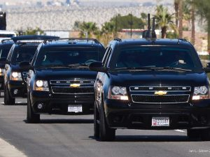 President Obama in a motorcade of Chevrolet Suburbans